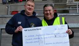 Ian Walkden presents £750 cheque to Martin Blondel of the SPF